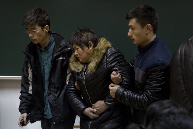 Relatives of a victim of the deadly stampede arrives at a room to wait for answers in Shanghai, China, Friday, January 1, 2015. (Photo by Ng Han Guan/AP Photo)