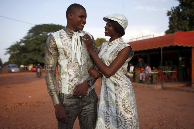 Models Darhat Diallo (l) and Oumou Soumare pose for a picture in bazin outfits made by designer Barros Coulibaly in Bamako, Mali, October 21, 2015. (Photo by Joe Penney/Reuters)