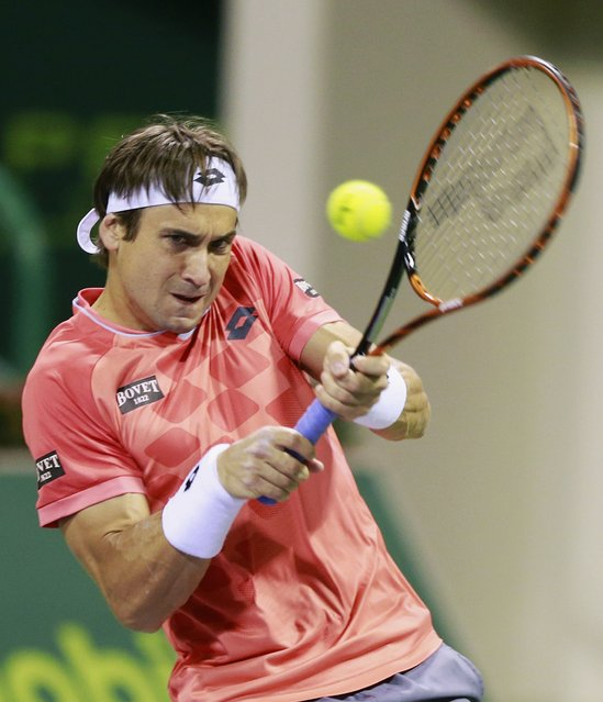 Spain's David Ferrer returns the ball to Croatia's Ivo Karlovic during their semi-final tennis match at the Qatar Open tennis tournament in Doha January 9, 2015. (Photo by Mohammed Dabbous/Reuters)