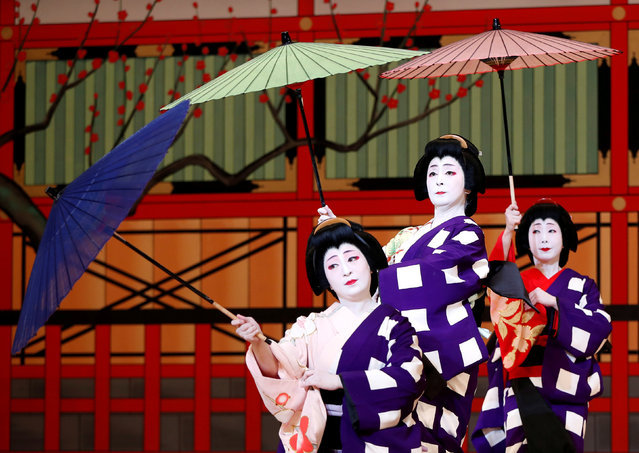 Geishas, traditional Japanese female entertainers, perform their dance during a press preview of the annual Azuma Odori Dance Festival at the Shinbashi Enbujo Theater in Tokyo, Japan May 23, 2018. (Photo by Issei Kato/Reuters)