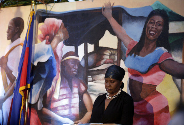 Marleine Bastien bows her head in prayer during an event commemorating the fifth anniversary of a devastating earthquake that struck Haiti, Monday, January 12, 2015, in the Little Haiti neighborhood of Miami. The 7.0 magnitude earthquake struck in 2010, and the Haitian government has said more than 300,000 people were killed. (Photo by Lynne Sladky/AP Photo)