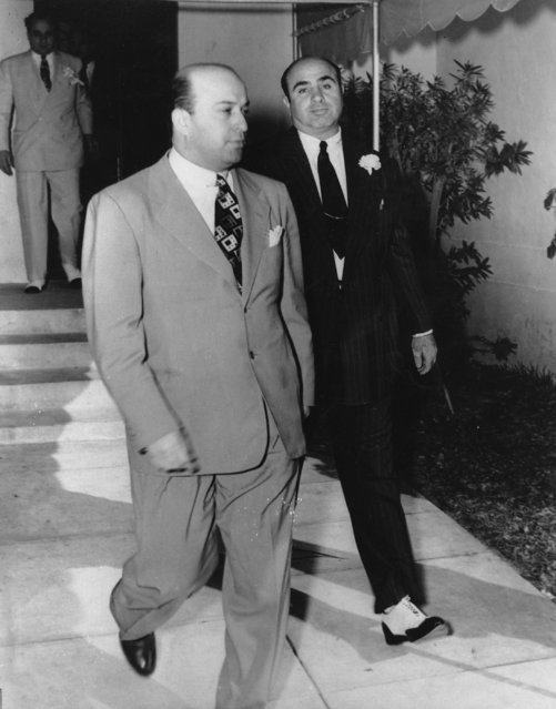 Al Capone, right, is shown in one of his last public appearances as he and his unidentified friend leave St. Patrick's Catholic Church after Capone's son's wedding in Miami, Fla. on December 30, 1941. (Photo by AP Photo)