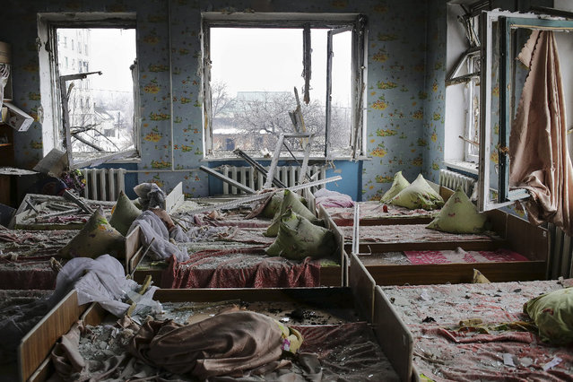 A general view of the kindergarten No9 which was shelled in Debaltseve, Donetsk area, Ukraine, 22 January 2015. The violence in eastern Ukraine surged again amid reports that government troops had given up Donetsk airport after months of fighting against pro-Russian separatists. (Photo by Anastasia Vlasova/EPA)