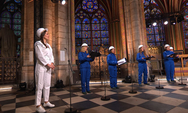 In this photo provided by Maitrise Notre-Dame de Paris soprani singer Julie Fuchs and the Notre Dame Cathedral choir recording a Christmas concert on Saturday, December 19, 2020, inside Notre Dame Cathedral in Paris. The concert will be broadcasted on French television on Christmas. (Photo by MSNDP/Musique Sacree à Notre-Dame de Paris via AP Photo)