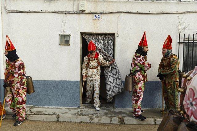 "Members of the Endiablada brotherhood pause before walking around the village during the ""Endiablada"" traditional festival in Almonacid Del Marquesado, Spain, Tuesday, February 3, 2015. (Photo by Daniel Ochoa de Olza/AP Photo)"