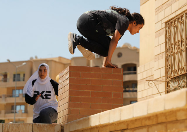 """Egyptian women from Parkour Egypt """"PKE"""" practice their parkour skills around buildings on the outskirts of Cairo, Egypt on July 20, 2018. The women have trained every week for the past six months with the eventual aim of forming the first professional Parkour team in Egypt. (Photo by Amr Abdallah Dalsh/Reuters)"""