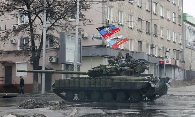 Pro-Russian separatists ride on a tank in Donetsk, eastern Ukraine, February 1, 2015. (Photo by Maxim Shemetov/Reuters)