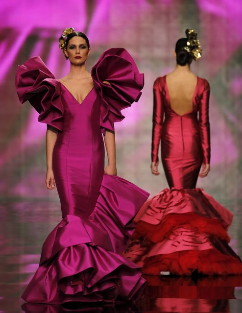 Models present creations by Vicky Martin Berrocal during the International Flamenco Fashion Show SIMOF in the Andalusian capital of Seville February 5, 2015. (Photo by Marcelo del Pozo/Reuters)