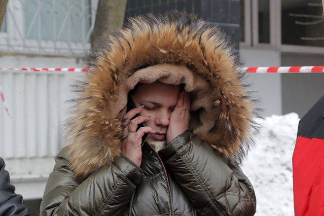 A woman reacts in the aftermath of an explosion at a nine-storey residential building in Khimki, outskirts of Moscow, Russia, 19 March 2021. (Photo by Maxim Shipenkov/EPA/EFE)
