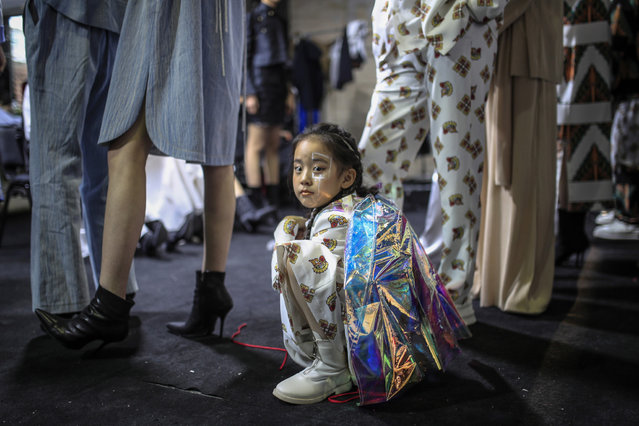 Models prepare backstage ahead the presentation of creations from the La Brocart by Owen collection during the China Fashion Week in Beijing, China, 31 March 2021. The fashion event runs from 24 March to 31 March 2021. (Photo by Wu Hong/EPA/EFE)