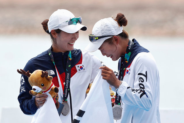 Silver medallists Kim Seul-gi and Kim Ye-ji of South Korea react during the victory ceremony for the women's double sculls rowing final during the 2018 Asian Games in Palembang on August 23, 2018. (Photo by Edgar Su/Reuters)