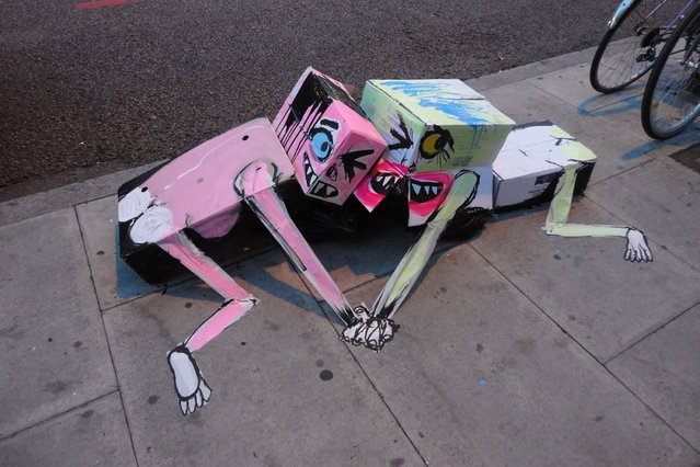 Spanish street artist Francisco de Pajaro is transforming London streets by turning filthy rubbish bins into inspired artworks, on September 12, 2013. (Photo by Caters News Agency)