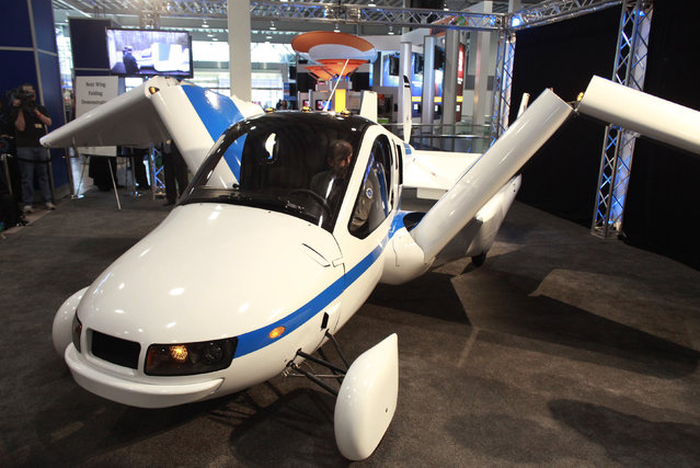 The Terrafugia Transition, a flying car, unfolds its wings at the 2012 New York International Auto Show at the Javits Center in New York, April 5, 2012. (Photo by Allison Joyce/Reuters)