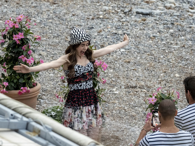 """Actress Lily Collins is seen filming on set of series 2 of """"Emily In Paris"""" on May 4, 2021 in Saint-Jean-Cap-Ferrat, France. (Photo by Arnold Jerocki/GC Images)"""