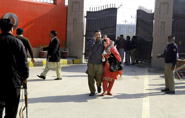 Staff of the Bacha Khan University leave the campus in Charsadda town, some 35 kilometers (21 miles) outside the city of Peshawar, Pakistan, Wednesday, January 20, 2016. (Photo by Mohammad Sajjad/AP Photo)