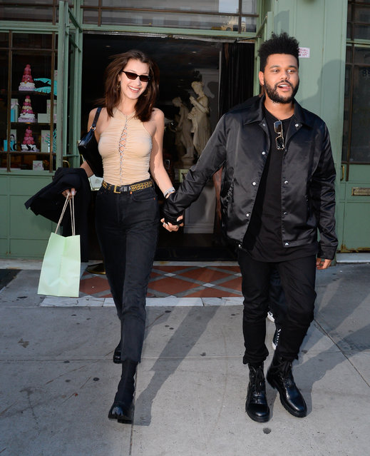 Model Bella Hadid and The Weeknd are seen in Soho on October 9, 2018 in New York City. (Photo by Raymond Hall/GC Images)