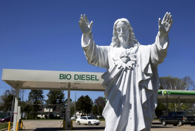 A statue of Jesus is seen outside a gas station in Dubuque, Iowa, April 30, 2015. (Photo by Jim Young/Reuters)