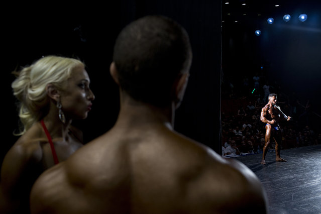 In this Thursday, October 18, 2018 photo, a contestant flexes for the judges during the National Amateur Body Builders' Association competition in Tel Aviv, Israel. Just short of 80 contestants participated in 14 categories at this year's competition. (Photo by Oded Balilty/AP Photo)