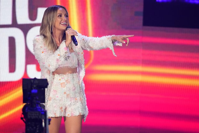 American country music singer and songwriter Carly Pearce announces performance by Thomas Rhett during the 2021 CMT Music Awards at Bridgestone Arena in Nashville, Tennessee, U.S. June 9, 2021. (Photo by Harrison McClary/Reuters)