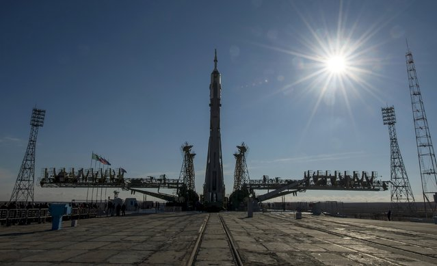 The Soyuz TMA-16M spacecraft is set on its launch pad at the Baikonur cosmodrome in this March 25, 2015 picture provided by NASA. The Soyuz is scheduled to blast off from Kazakhstan on March 28, with Russian cosmonauts Mikhail Kornienko, Gennady Padalka and NASA astronaut Scott Kelly to the International Space Station. (Photo by Bill Ingalls/Reuters/NASA)