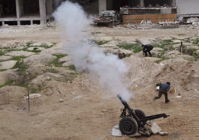 Free Syrian Army fighters launch a weapon towards the forces of Syria's President Bashar al-Assad in Ain Tarma, in Eastern Ghouta, a suburb of Damascus January 3, 2015. (Photo by Msallam Abd Albaset/Reuters)