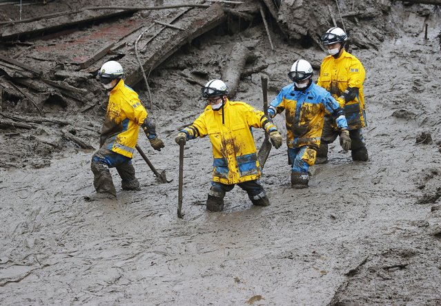 Rescuers conduct a search operation at the site of a mudslide at Izusan in Atami, Shizuoka prefecture, southwest of Tokyo, Sunday, July 4, 2021. More than 1,000 soldiers, firefighters and police on Sunday waded through a giant mudslide that ripped through the resort town as it swept away houses and cars. (Photo by Kyodo News via AP Photo)