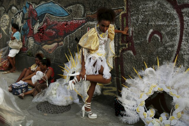 A reveller gets ready before the first night of the Carnival parade of samba schools in Rio de Janeiro's Sambadrome February 7, 2016. (Photo by Pilar Olivares/Reuters)