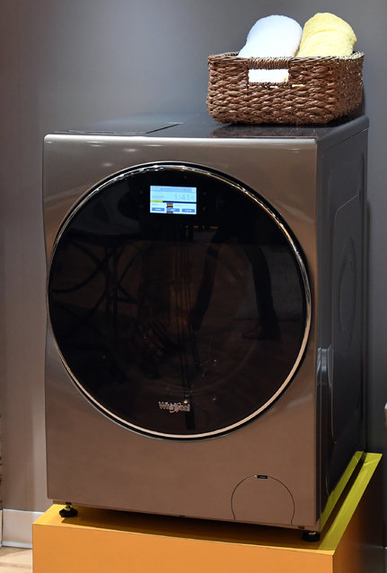 Whirlpool's All-In-One Washer and Dryer Combo is displayed at CES 2017 at the Sands Expo and Convention Center on January 5, 2017 in Las Vegas, Nevada. The USD 1,499 unit will be available at the end of this year and does not require the user to transfer clothes from a washer to a separate dryer and automatically dispenses the correct amount of detergent based on each load. (Photo by Ethan Miller/Getty Images)