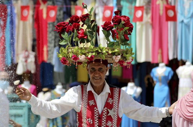 A flower seller is pictured at the old market in Tunis, Tunisia, Friday, July 30, 2021. Days of political turmoil in Tunisia over the economy and the coronavirus have left its allies in the Middle East, Europe and the United States watching to see if the fragile democracy will survive. (Photo by Hassene Dridi/AP Photo)