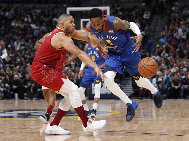 Houston Rockets guard Eric Gordon, left, knocks the ball away from Denver Nuggets guard Will Barton during the second half of an NBA basketball game Friday, February 1, 2019, in Denver. The Nuggets won 136-122. (Photo by David Zalubowski/AP Photo)