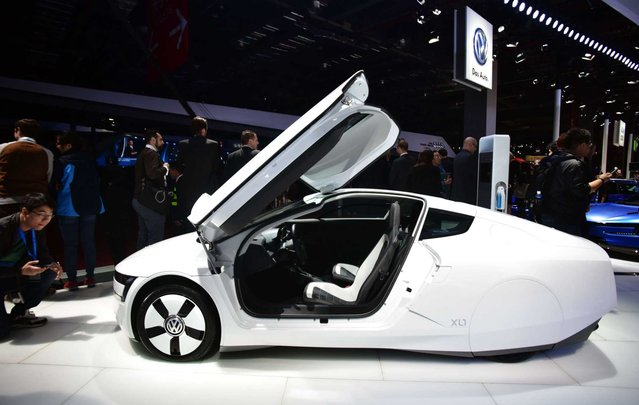 A VW XL1 concept car is displayed at the 16th Shanghai International Automobile Industry Exhibition in Shanghai on April 20, 2015. (Photo by Johannes Eisele/Getty Images)