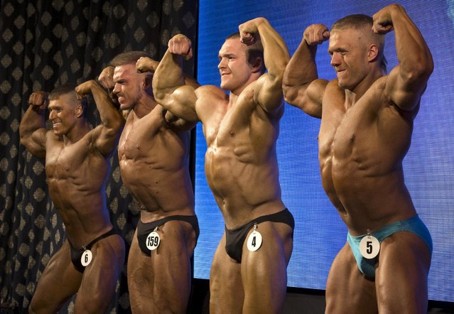 Participants take part in Belarus bodybuilding and fitness championship in Minsk April 25, 2015. (Photo by Vasily Fedosenko/Reuters)
