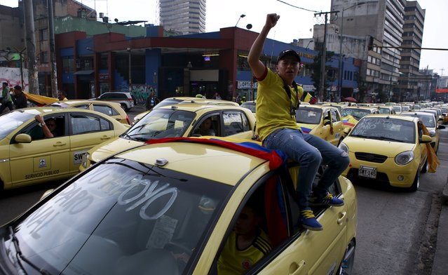 Cab drivers block an avenue to protest against the Uber ride sharing service in Bogota, Colombia, March 14, 2016. (Photo by John Vizcaino/Reuters)