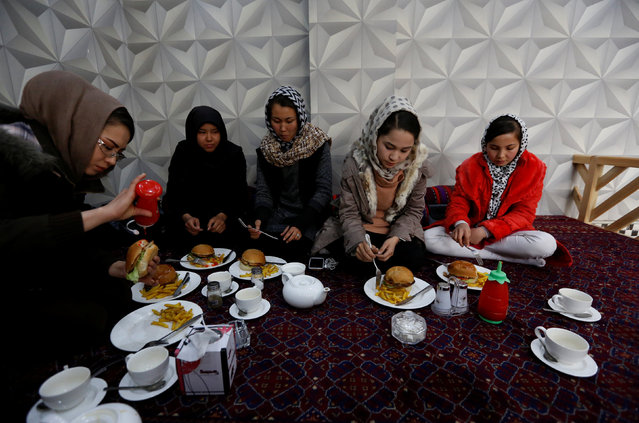 Sima Azimi (L), 20, a trainer at the Shaolin Wushu club, eats lunch with her students at a restaurant in Kabul, Afghanistan February 2, 2017. (Photo by Mohammad Ismail/Reuters)