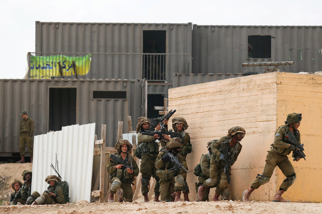 Israeli soldiers from the Nahal Infantry Brigade take part in an urban warfare drill at an army base near Arad, southern Israel February 8, 2017. (Photo by Amir Cohen/Reuters)