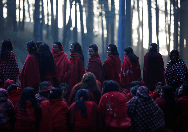 Devotees gather while performing religious rituals during the Swasthani Bratakatha festival in the woods of Changu Narayan in Bhaktapur, Nepal February 8, 2017. (Photo by Navesh Chitrakar/Reuters)