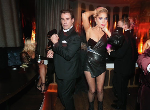 Actor John Travolta (L) and recording artist Lady Gaga attend Interscope's Grammy After Party with Lady Gaga at the Peppermint Club on February 12, 2017 in Los Angeles, California. (Photo by Christopher Polk/Getty Images for Interscope)