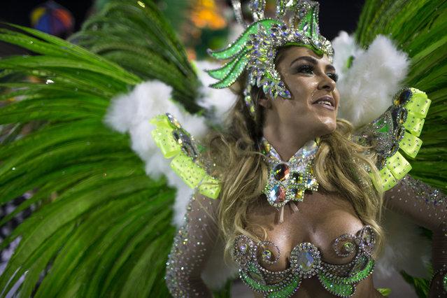 A performer from the Mocidade samba school parades during carnival celebrations at the Sambadrome in Rio de Janeiro, Brazil, Monday, March 3, 2014. (Photo by Felipe Dana/AP Photo)