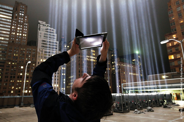 Lighting Designer Frank Hollenkamp uses his iPad to shoot video of the Tribute in Lights ahead of the tenth anniversary of the September 11 terrorist attacks
