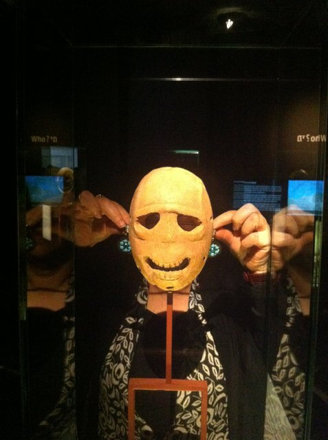 """The Israel Museum in Jerusalem posted on its Facebook page this visitor """"selfie"""" with one of the oldest masks in the world. The collection of 9,000-year-old stone masks worn during Stone Age ceremonies is currently on display at the museum. (Photo by Israel Museum, Jerusalem/Facebook)"""