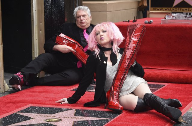 """Cyndi Lauper and Harvey Fierstein (L) pose for photographers after they receive stars on the """"Hollywood Walk of Fame"""" in Los Angeles April 11, 2016. (Photo by Phil McCarten/Reuters)"""