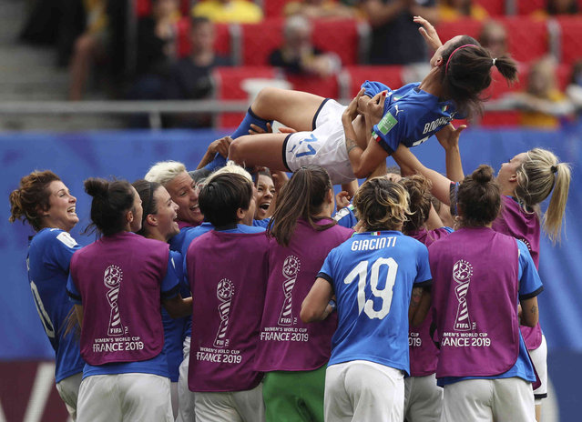 Italy's Barbara Bonansea is tossed in the air by teammates after their victory in the Women's World Cup Group C soccer match between Australia and Italy at the Stade du Hainaut in Valenciennes, Sunday, June 9, 2019. (Photo by Francisco Seco/AP Photo)