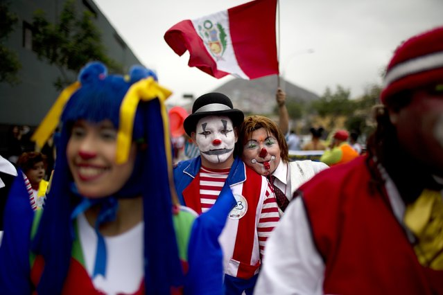 Clowns march while commemorating the Peruvian clown day in Lima Peru, Monday, May 25, 2015. (Photo by Rodrigo Abd/AP Photo)