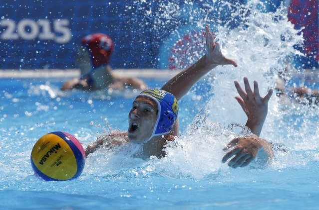 Vladislav Dulin of Ukraine, left, fights for the ball with Nikita Krug of Russia during the water polo competition at the 2015 European Games in Baku, Azerbaijan, Saturday, June 13, 2015. (AP Photo/Dmitry Lovetsky)