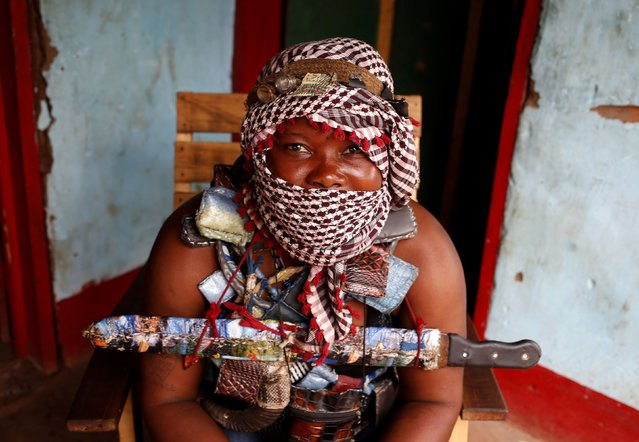 A masked female member of the anti-balaka, a Christian militia, sits in the village of Zawa, April 8, 2014. (Photo by Goran Tomasevic/Reuters)
