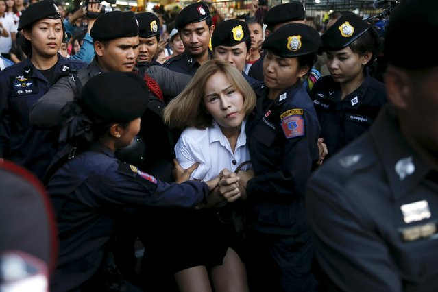 """A student activist is detained during a silent protest after Thailand's election commission filed charges against a group for posting """"foul and strong"""" comments online criticising a military-backed draft constitution, in Bangkok, Thailand April 27, 2016. (Photo by Jorge Silva/Reuters)"""