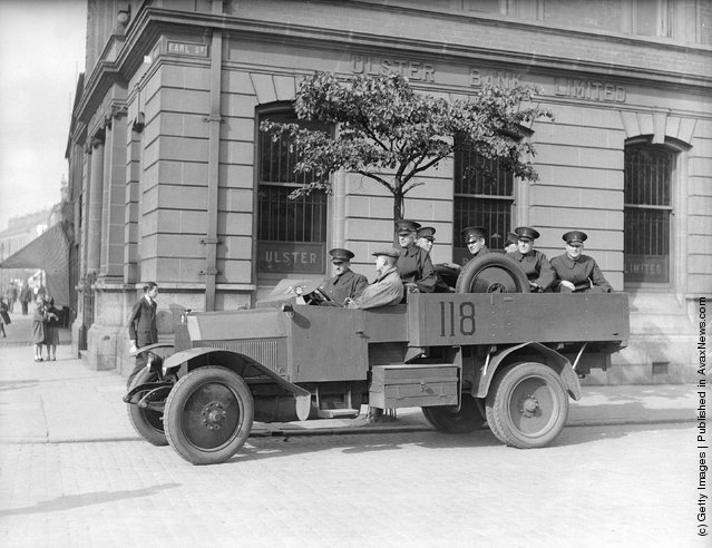 1935:  A Royal Ulster Constabulary armoured car patrolling near York Street in Belfast following riots after an Orange Order parade
