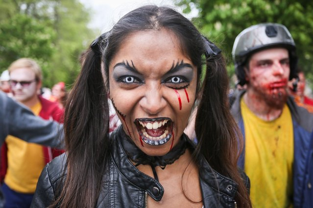 A young woman dressed as a zombie takes part in a zombie parade as part of the Brussels International Fantastic Film Festival 2014 in Brussels, Belgium, 12 April 2014. More than a hundred of participants took to the streets of Brussels. (Photo by Ulien Warnand/EPA)