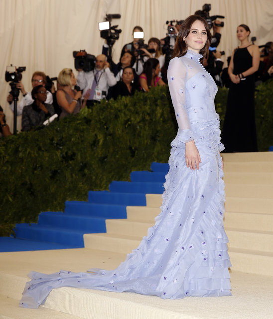 """Felicity Jones attends """"Rei Kawakubo/Comme des Garcons: Art Of The In-Between"""" Costume Institute Gala – Arrivals at Metropolitan Museum of Art on May 1, 2017 in New York City. (Photo by Carlo Allegri/Reuters)"""