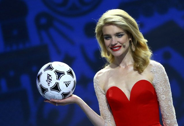 Presenter Natalia Vodianova holds a soccer ball with autographs signed by her guests during the preliminary draw for the 2018 FIFA World Cup at Konstantin Palace in St. Petersburg, Russia July 25, 2015. (Photo by Reuters/Stringer)